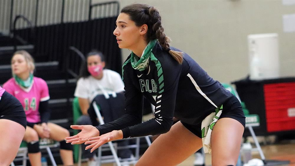 McKenna Marrs prepares for a volleyball serve