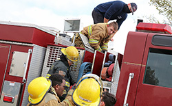 A photo of students working on a fire truck