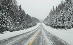 A photo of a snowy road